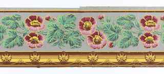 Between striped edgings, the wide central band contains flowers enframed by cartouches which are separated by garlands of flowers. Each cartouche has eight points alternating between palmettes and rosettes/acanthus leaves. The background is flocked. Printed in yellow, gold, green, blue, red and pink on a purple flocked background.