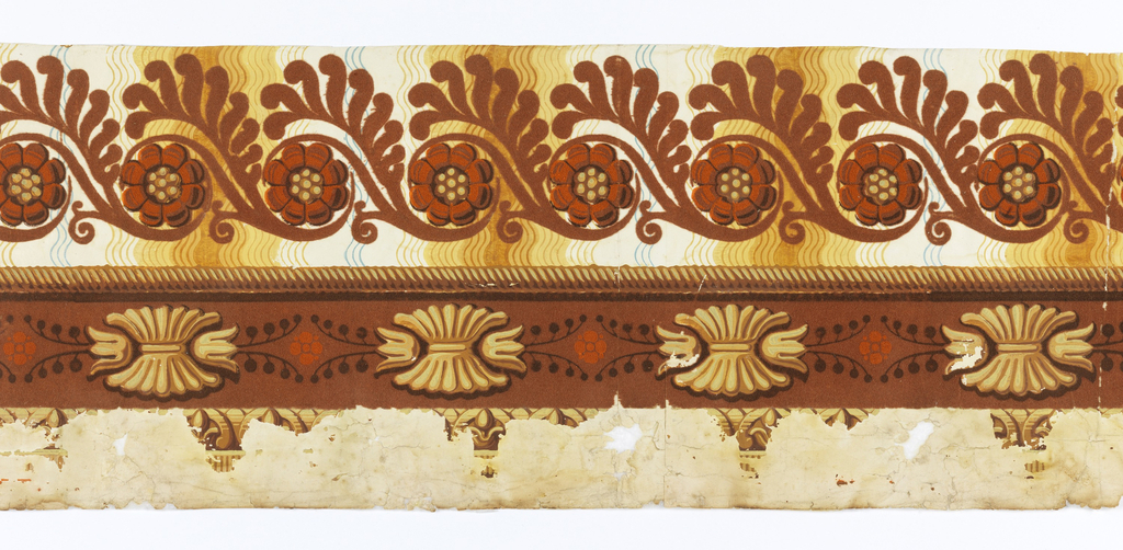 Flocked rinceau pattern on a wavy background.  Cable molding.  Band of gadrooning motifs and flowers.  Bottom of border has heavy pigment loss but possible egg and dart motif.  Printed in orange, shades of yellow and brown.  H# 318