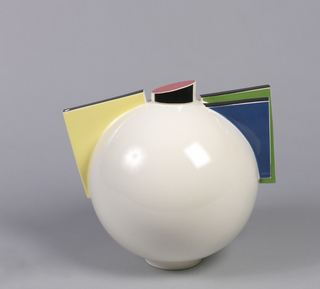 Spherical,white-glazed teapot (a) on circular foot; short cylindrical lid (b) with angled top, glazed in pink and black; on one side of body, large angled square spout glazed in yellow with black edges, with small hole at top; similar angular handle oposite, composed of two overlapping squares glazed in blue and green, with black edges.
