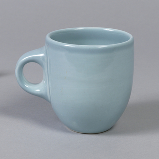 "Cylindrical slightly tapered form with thick circular loop handle; ""ice blue"" glaze."