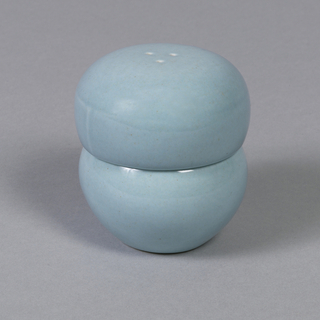"""Shaker (a) of squat globular form pierced with three holes at top, cork stopper (b) in bottom; """"ice blue"""" glaze."""