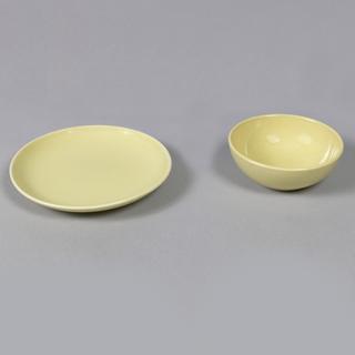 "Circular form, raised edge at rim; ""avocado"" yellow-green glaze."