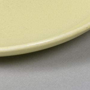 "Circular form, raised edge at rim; ""avocado"" yellow-green glaze."