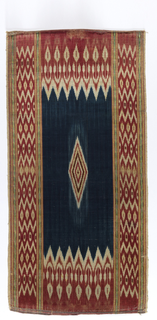a: Panel (one of two with 1931-4-20-b), probably for wall hanging. Ribbed cotton weft, and warp of silk, chine technique – geometric design – borders and edges of red, white, brown, a little yellow and green – small diamond-shaped design in center (striped red, white, brown and yellow) on field of deep blue – Arabic stamp on back.