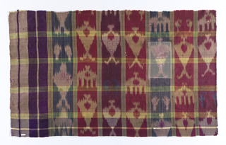 Oblong panel with a large plaid design made by groups of white and green stripes. Warp print pattern in shades of purple, red, blue, green and yellow. Pattern of a tree appears in alternate rows.