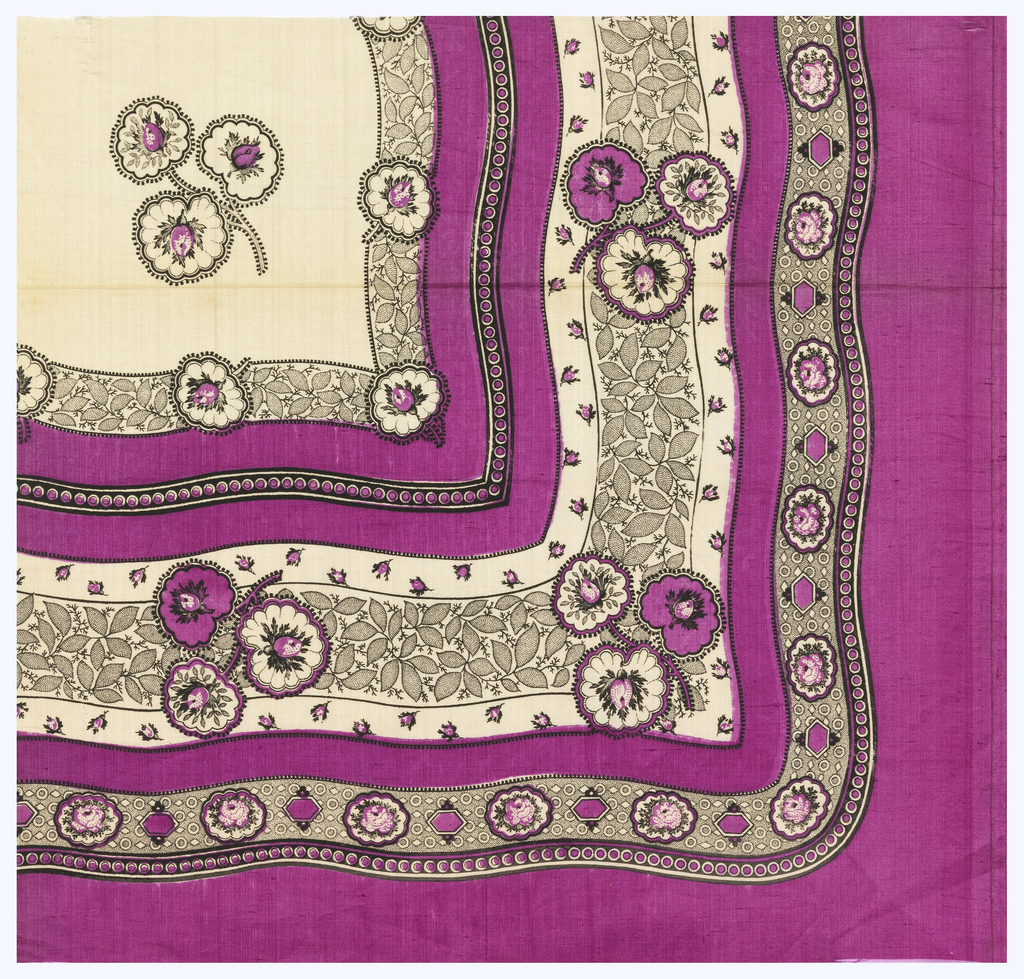 Quarter of a printed scarf with wavy floral border in magenta and black and a field showing isolated flowers.