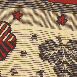 Quarter of a printed scarf in red and black. Shows field of plain red and border of shamrocks and small leaves.