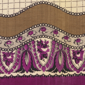 Quarter of a printed scarf in magenta, tan, white, and black. Field of plain magenta and wavy-edged border with medallions.
