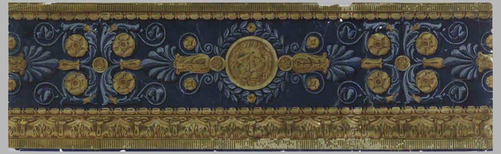 Horizontal design, in yellow and green on a blue field. Rosette and foliage scrolls, with bead-and-reel across top, and bead-and-reel and leaf across bottom.