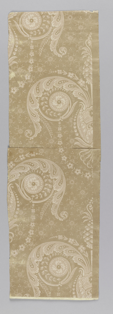 Vertical rectangle. Foliate scrolls, palmette and pineapple, against a slightly glazed field. Printed in pale pinks on darker neutral pink ground.