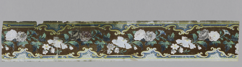 Border strip, with serpentine streamer of flowers and foliage between rocaille strips. Printed in blue, gray, green, brown and yellow with brown flock.