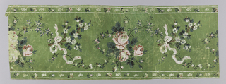 Border is vertical. Center panel has bunch of roses alternating vertically with branch of apple blossom tied with pale pink ribbon. Small white-edged bands at right and left have small sprigs, buds and flowerlets in vertical columns. Printed on green ground.