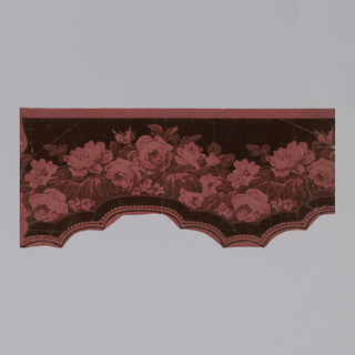 Cut-out floral swag design, printed in shades of red on red ground.