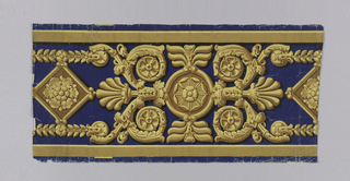 Border design simulating a gilt bronze mount. Printed in shades of yellow ocher on a deep blue ground.