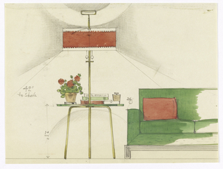 Brass (?) floor lamp with red shade; circular glass table at center holding a plant, lighter, ashtray and books. At right, partial view of green sofa with red pillows.