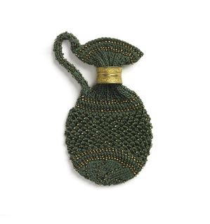 Knitted purse in the shape of a jug and ornamented with copper-colored beads.