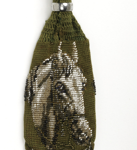 Miser's purse crocheted of green silk and ornamented with china, glass and steel beads and a silk tassel.  Fitted with two steel rings.
