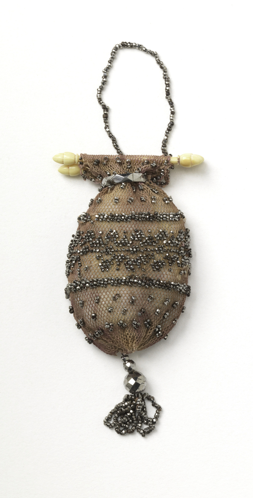 Rose color silk net, crocheted; ornamented with cut steal beads. Steel ring to slide and close. Fitted at top with small ivory or bone bars to open. Cut steel pendant; steel chain to carry.