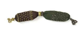 One side in green crocheted silk with cut steel beads; the other in brown silk ornamented with gold beads. The side opening is controlled by two rings, one of cut steel, the other of gold. A cut steel tassel is attached to the green silk end while an ornamental gold drop decorates the brown end.