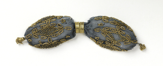 Crocheted blue silk ornamented with gold beads and cut steel beads in stylized floral pattern.  Two gold rings control side opening.  Gold drop with beads at either end.