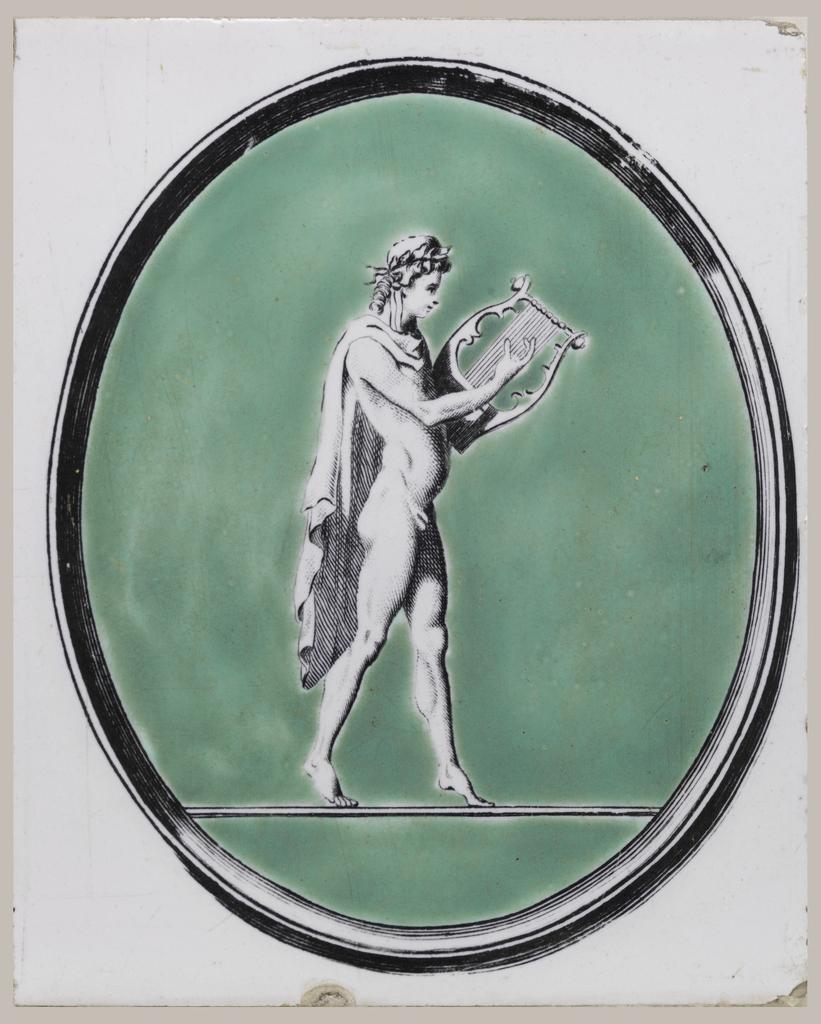 Vertical rectangle. White glazed ground; upright oval black transfer-printed frame enclosing green area against which, in black on white, is a figure of Orpheus or Apollo holding a lyre.