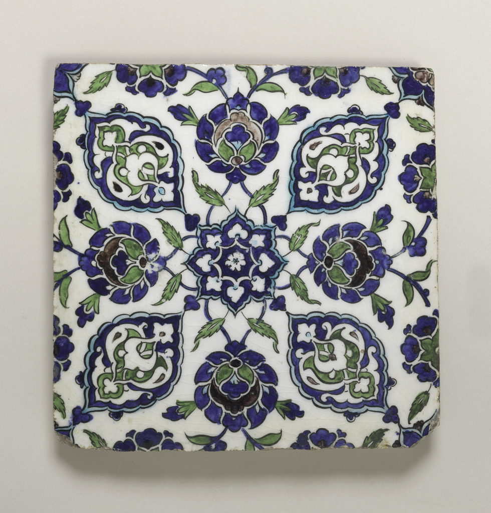 Square in shape, painted with an 8-pointed blossom in the center, from which radiate stylized floral arabesques and blossoms.