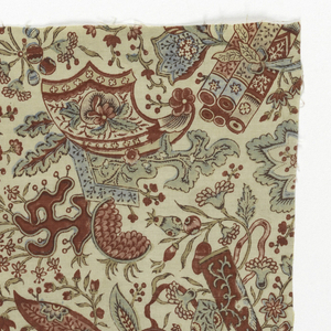 Fragment of printed cotton with fantastical floral forms and chinoiserie motifs, including single and bundled scrolls. Printed in blue, green, yellow, and several shades of purple, red and pink on an off-white ground.