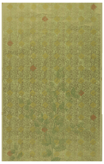 On beige ground, all-over geometric pattern (reminiscent of Oriental tea foil patterns), in metallic gold, punctuated by filled diamonds of mustard yellow and of brick red at junctures of pattern. Subtle vertical stripings of pale green overprinted, and on top of all, overprinted in broken areas of gray-green. One large-scale plant sprig printed.