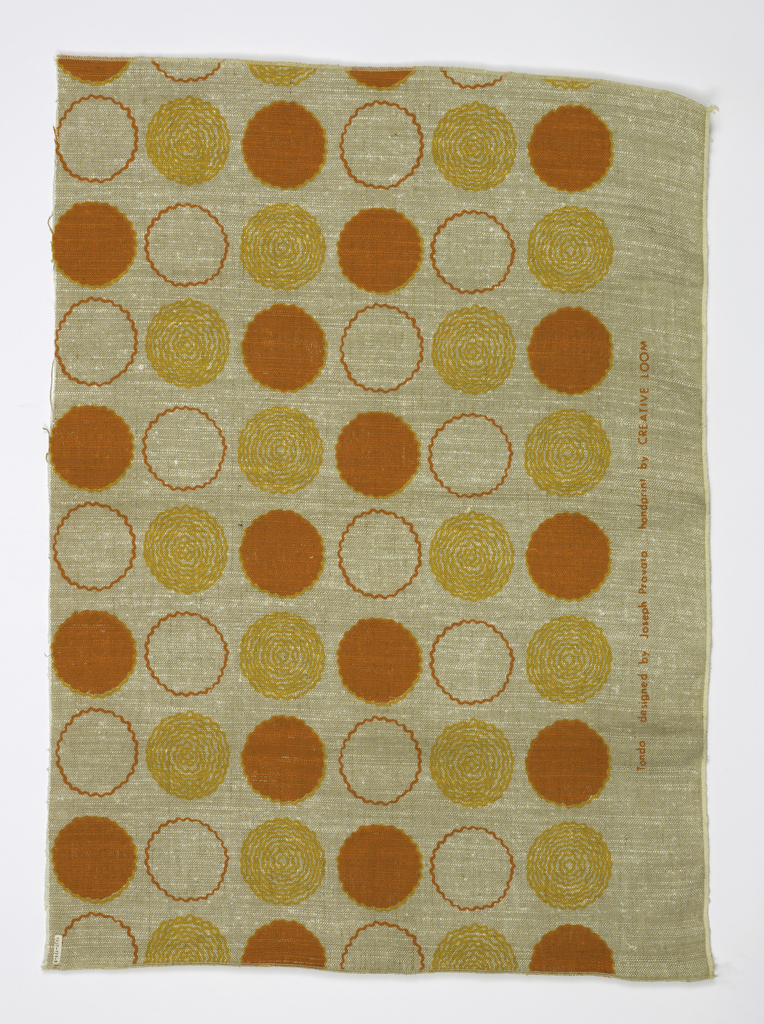 Heavy natural linen screen printed with three inch circles in orange and yellow.