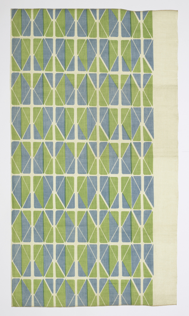 Printed in green and blue on white linen in a design of rectangles made from triangles.