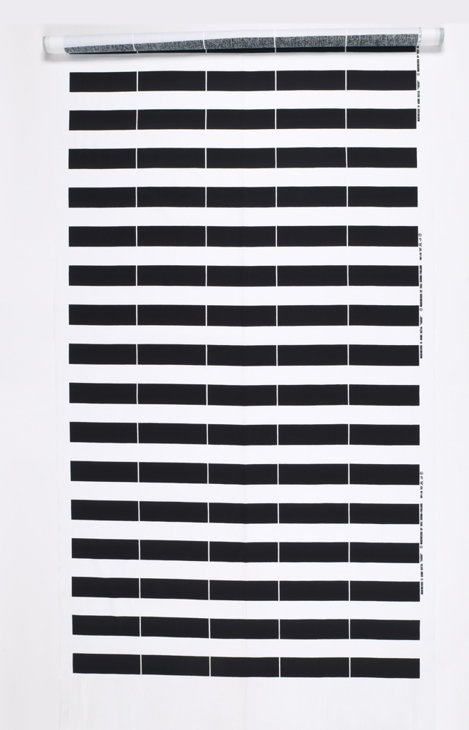 Printed textile with horizontal stripes of black and white. The black bands are interescted by fine vertical white lines.