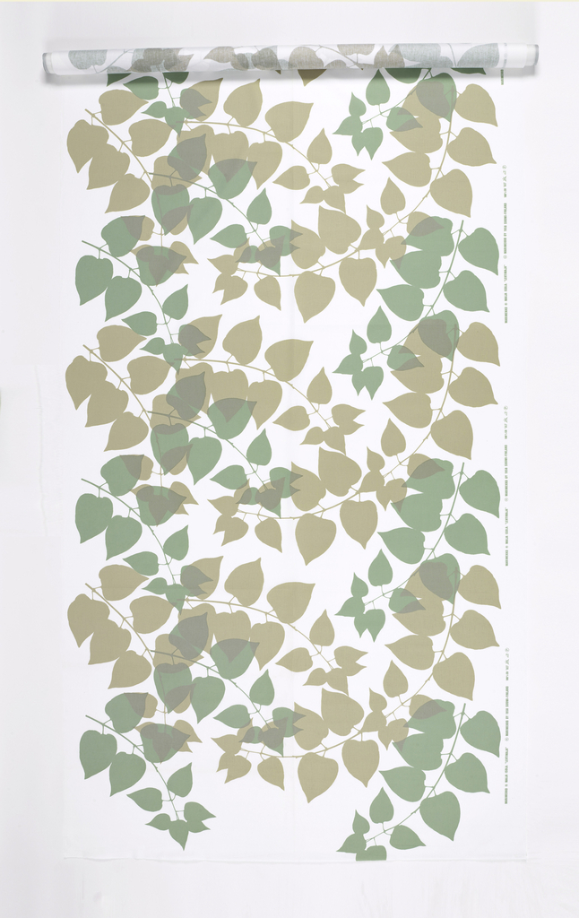 All-over pattern of leaves in tan and green on a white ground.