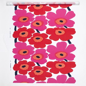 Length of printed cotton with a bold, abstracted design of red and pink poppies with black centers and stems on a white ground.