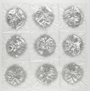White sheer polyester square with a grid of nine silver circles, slightly crimped from the shibori process.