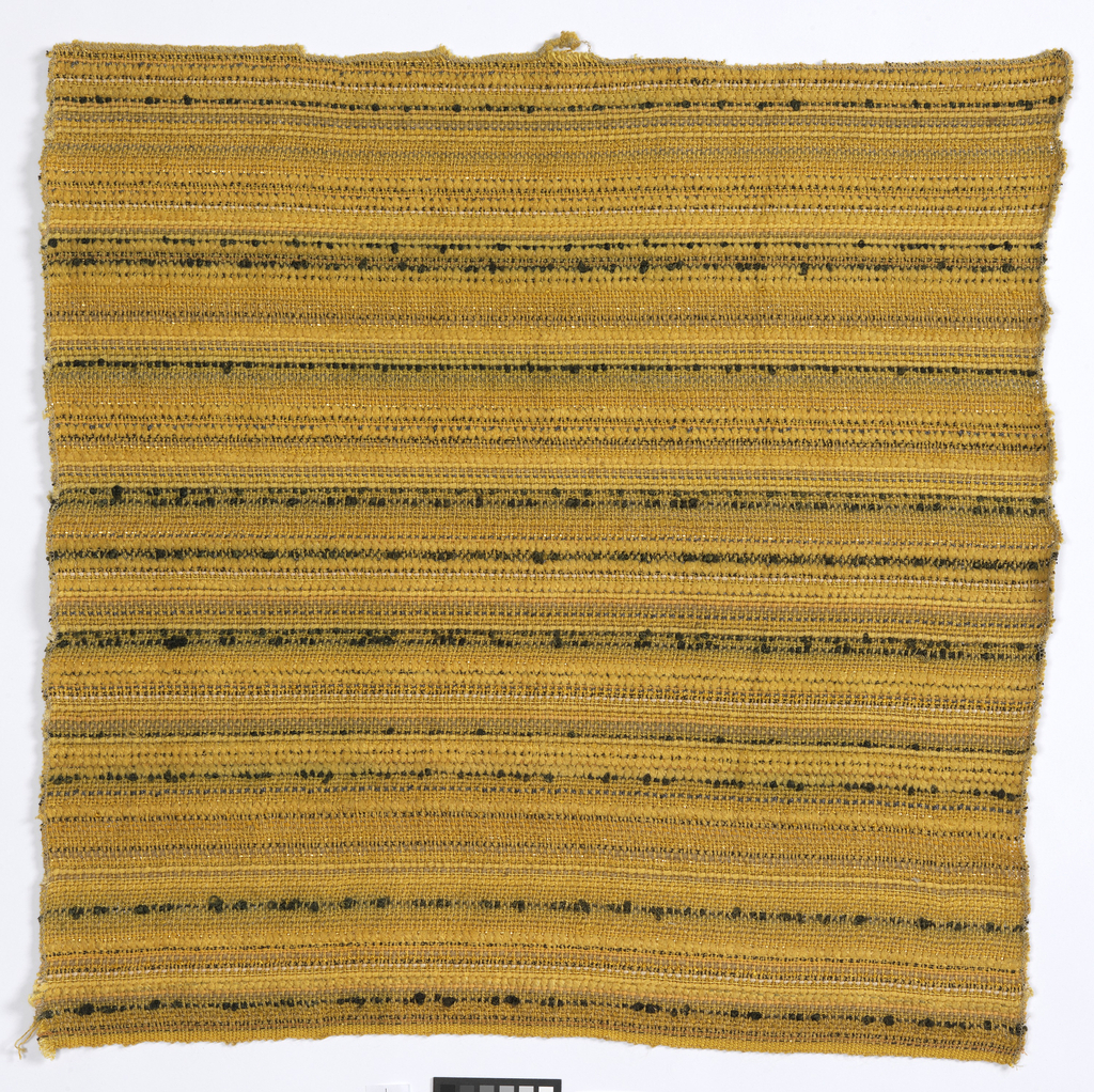 A suble horizontal stripe created by using wefts in various shades and textures of gold and small amounts of black.