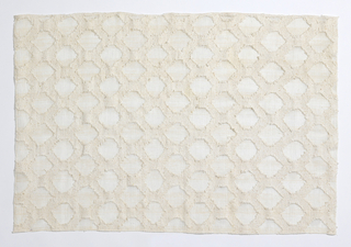 White on white transparent/ opaque pattern of a dense diamond grid enclosing open gauze areas