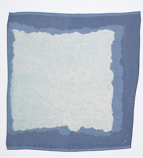 Square scarf with a white field and irregular border in two shades of blue. Crinkled scarf used as a stencil.