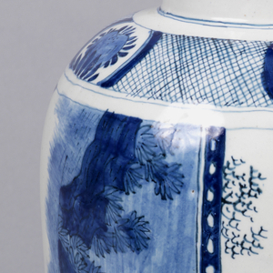 Ovoid body; short, straight-sided neck; painted in underglaze blue on white on sides with chinoiserie scenes of figures in pavillions and gardens, surrounded by 2 floral and scroll borders bottom, diaper and floral reserves above.