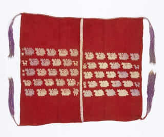 Warp-faced red cotton cloth with central horizontal band of stylized animals in white and purple silk floss. Seamed down center with same colors. Long tassels of purple floss at each corner.