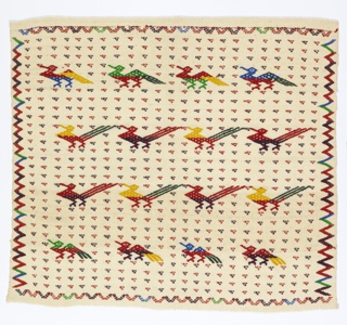 Loosely woven square with selvage on two sides, loom ending on one end, and hemmed at top, in undyed cotton. Patterned with rows of stylized birds in red, blue, green and yellow, small triangles, and zigzag border.