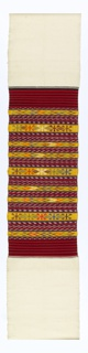 Long white cotton panel with broad central area of red, yellow, and green stripes with geometric motifs and zigzags and blue and white ikat patterned stripes.