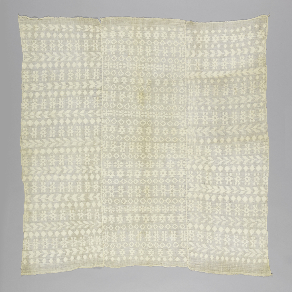 Panel, most likely made for a huipil, comprised of three narrow panels of white hand-woven cotton, patterned in geometric design. Center panel has slightly different pattern from side panels.