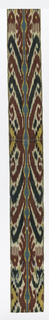 Vertically and horizontally symmetrical ikat in red, green, yellow and blue with floral towards bottom. Blue vertical line running down the center with circular/bulbous areas that meet diagonal lines with curved/hooked ends in red and green.