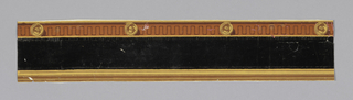 Border consists of a flocked band with a narrow crenallated fret with rosettes on the top edging. The bottom is edged with stripes. Printed in black flocking, yellow, terra cotta, ochre, brown on fucia ground.