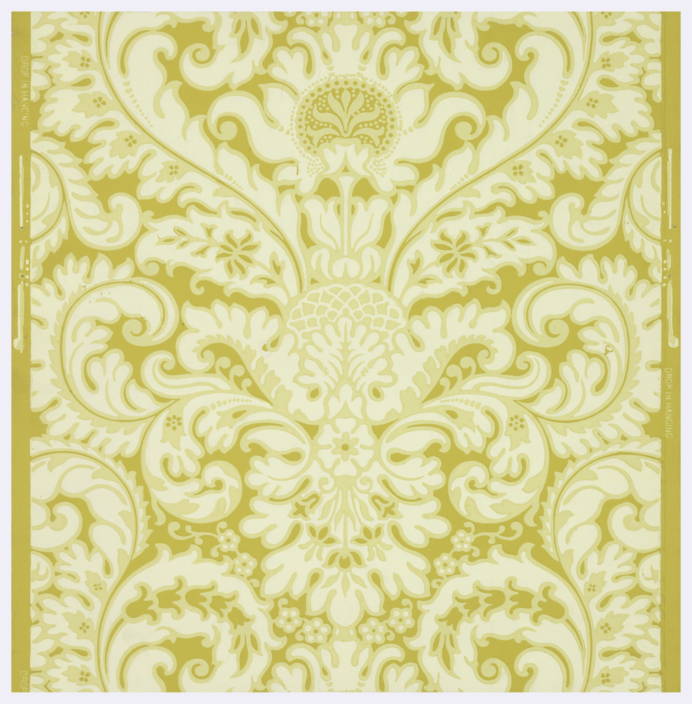 Large-scale scrolling acanthus leaves forming central vertical design. Printed in off-white on ocher ground.