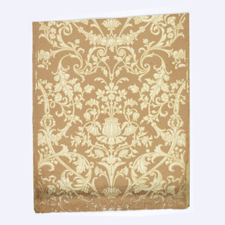 Central floral motif, surrounded by more flowers and scrolling foliage. Printed in tan and white on rust-color ground.