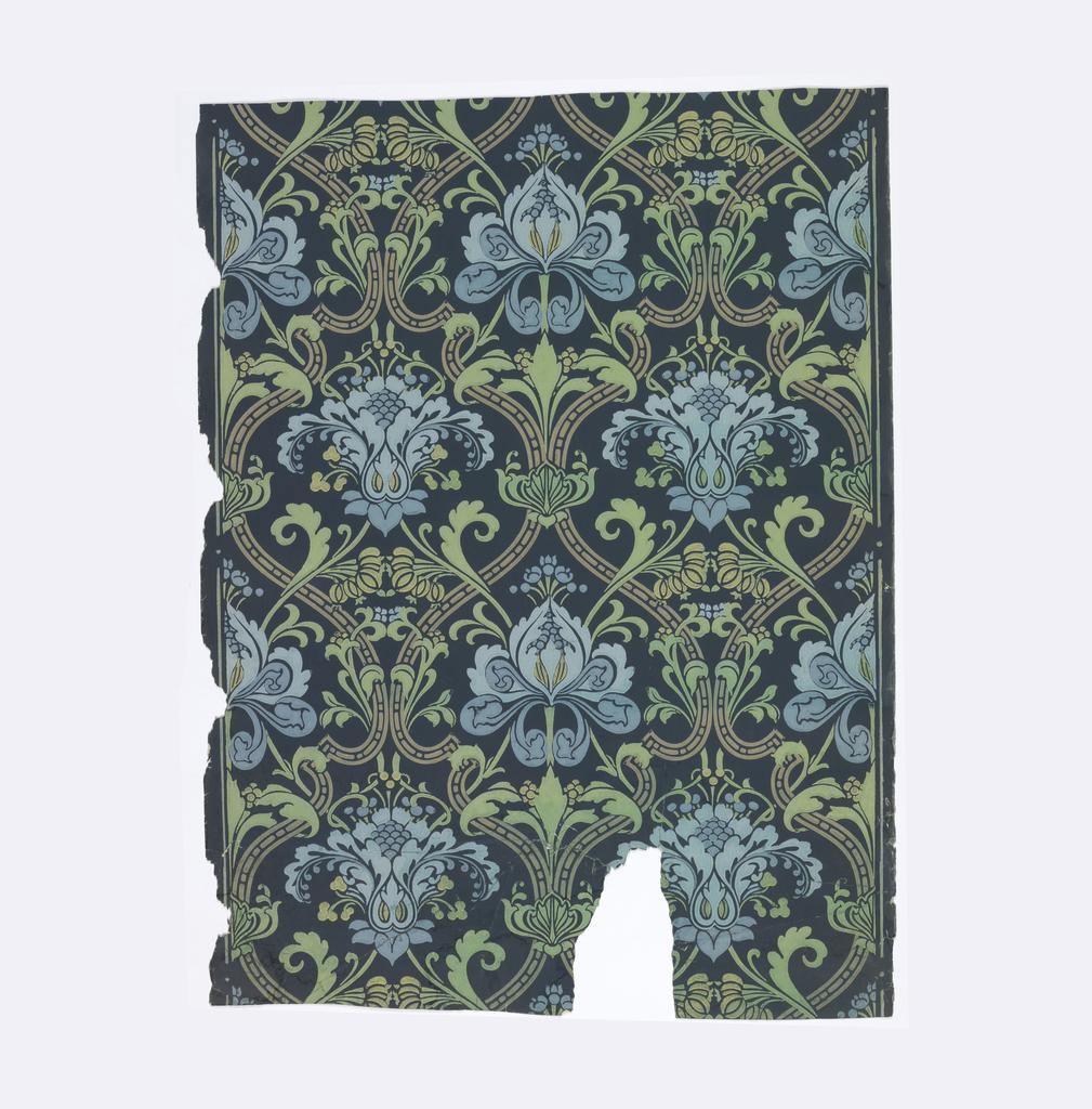 Stylized blue flowers set within tan diaper framework. Printed on dark blue ground.