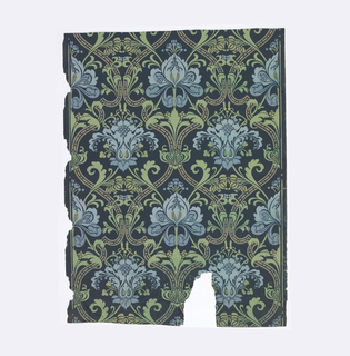 Stylized blue flowers set within tan diaper framework. Printed on dark blue ground.