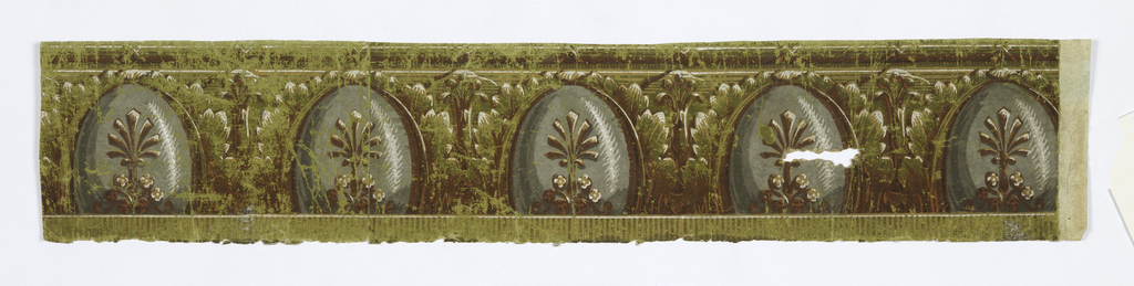 A row of egg-shaped forms, resting on truncated bottoms, outlined in foliage. Each egg contains highlights and a stylized foliate stem with flower and curl decorations at the base. Bottom edge has dentilling, and vestigial dentilling is under stripes of the top edging. Printed in chartreuse, brown, grey, tan, white.  H# 513