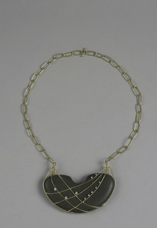 Gold chain necklace with pendant half moon stone caged in gold and diamonds.